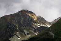 Beam of Light on Mountain Peak