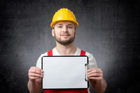 Worker showing blank clipboard