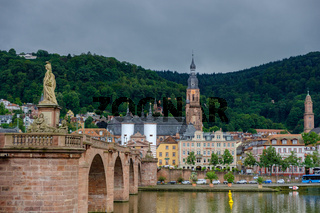 View of the beautiful medieval city of Heidelberg and river Neckar in Germany with the Old Bridge in the foreground.