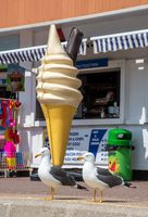 10 May 2019: Large Plastic icecream in front of shop with seagulls sitting in foreground