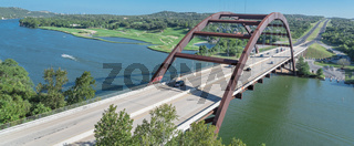Panoramic Pennybacker Bridge over Colorado river and Hill Country landscape in Austin