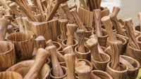 Set wooden utensils for cooks. spoons, mallets, forks and cutlery handmade in handcrafted wood