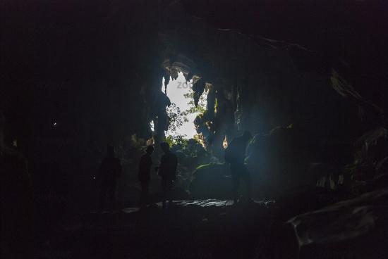 Exploring caves near Vang Vieng