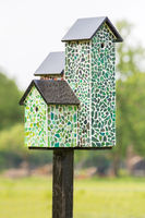 Nest boxes with mosaic tiles on pole