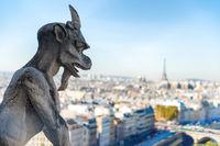 Gargoyle statue on Notre Dame de Paris