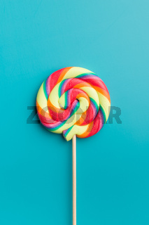 Colorful rainbow swirl lollipop.