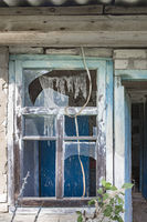 Window with broken glass on an abandoned home in the exclusion zone of Chernobyl in Belarus (White-R