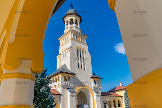 Beautiful view to the Coronation Reunification Cathedral Bell Tower in Alba Iulia city, Romania. A Bell Tower on a sunny day in Alba Iulia, Romania