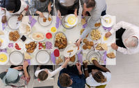 top view of modern multiethnic muslim family having a Ramadan feast