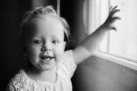 Portrait of happy one year old girl in black and white