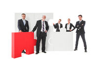 Business team and puzzle elements