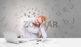 Business person sitting at desk with editorial concept