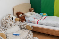 Feel-good corner in the nursery with babyphone and stuffed animals
