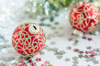 Red Christmas balls with gold ornament.