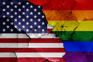 flags of USA and LGBT painted on cracked wall