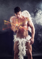 Male angel with white wings in studio shot