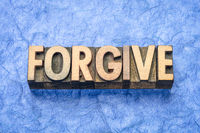 forgive word in wood type