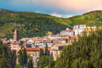 panoramic italian town of Tivoli near Rome in Lazio surrounded by a lush forest