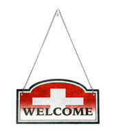 Switzerland welcomes you! Old metal sign isolated
