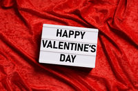 happy valentines day lightbox on red velvet background