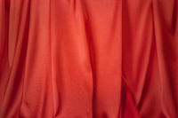 Abstract red silk textile background