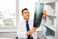 doctor with x-ray scan at hospital