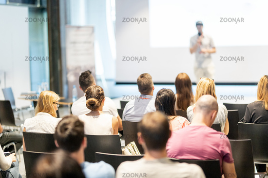 Male business speaker giving a talk at business conference event.