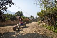 Man driving tractor, Vang Vieng