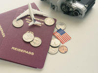 Travel concept with passport and money on a table