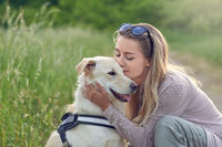 Happy smiling dog with its pretty young owner