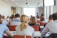 Academic presentation in lecture hall at university.