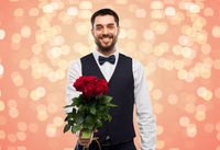 happy man with bunch of red roses