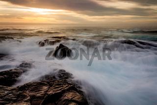 Mystical light over the ocean  with rocky ocean cascades