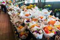 Bouquets of varied flowers in a stand at the Pike Place Market in Seattle