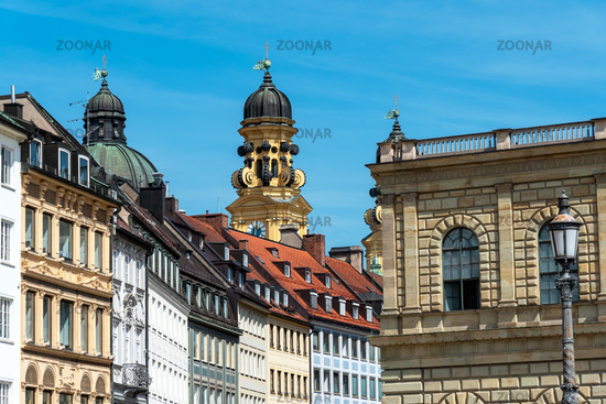 Old houses in downtown Munich with the Theatine Church in the back