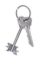 pair of door keys on keyring isolated on white