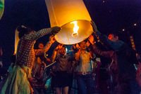Lighting up a lantern, Chiang Mai