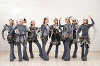 Group of young dancers in fantastic costumes shot