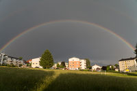 double closed rainbow shines in thunderstorms