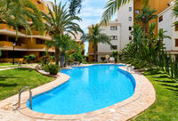 Orihuela, Spain- May 9, 2019: Idyllic place for vacationers residential high rise building house with swimming pool closed urbanization area green lawn for relaxation, Punta Prima, Torrevieja, Spain