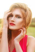 beautiful girl wiith red lips near lake