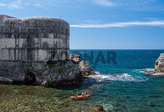 Canoe by the city walls of the old town of Dubrovnik in Croatia