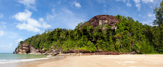 Exotic sand beach and cliffs with forest