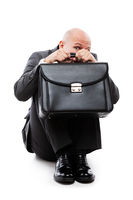 Unhappy scared or terrified businessman in depression hand holding briefcase