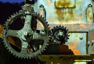 Vintage oily and rusty cogwheel at night