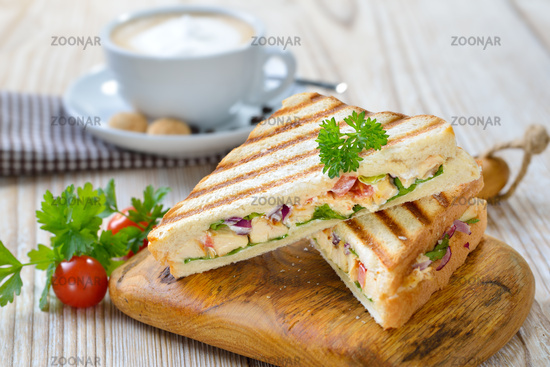 Grilled sandwich with a coffee