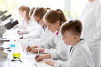 kids studying chemistry at school laboratory