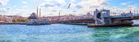 New Valide Sultan Mosque and the Galata Bridge, panorama from the Bosphorus. Istanbul, Turkey