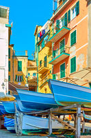 Boats in the street and old colorful houses in Riomaggiore