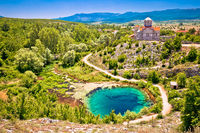 Cetina river source water hole and Orthodox church aerial view